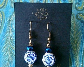 Gold pagoda drop earrings