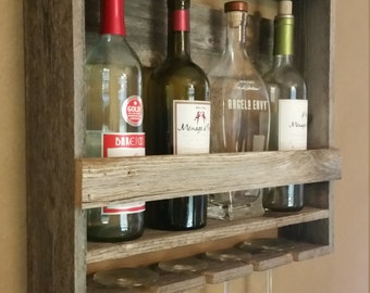 Beautiful rustic wine bottle and glass display rack