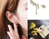 Asymmetric ear cuff stud earrings with a leaf, chain drop, zircon and alloy.