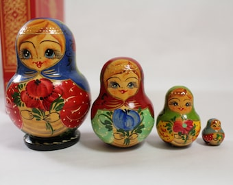 Collectable Russian Nesting Dolls 4 pieces, Maiden Holding Flowers, Matryoshka, Babushka, Hand Painted and Signed 1996