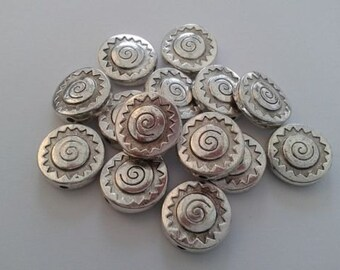 100 flat round Antique silver colour beads. 12mm diam, 3mm thick, hole 1.5mm