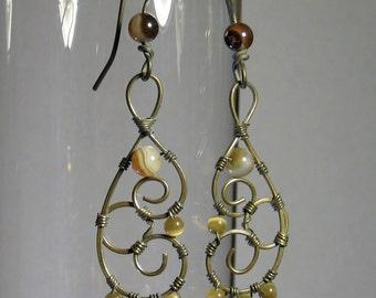 Brass earrings with cat's eye beads