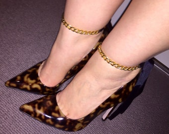 Gold chain anklets with black ribbon ties