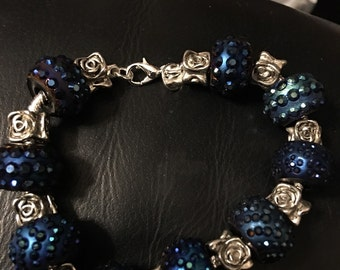 Sterling Silver Bracelet with Blue Glass beads and silver spacers.