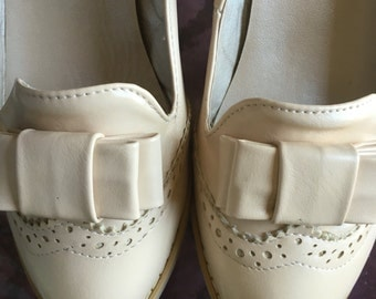 Cream Spectator Pumps w/Bow Detail