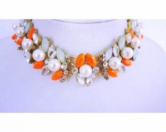 Statement necklace with orange, blue and pearl stones