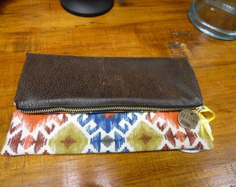Fold over clutch with zip closure