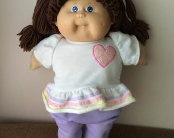 Cabbage Patch Kids doll, brown hair, blue eyes, 1985