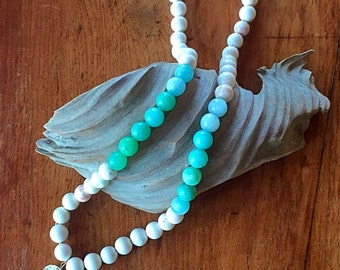 Hand painted oyster shell and glass bead necklace
