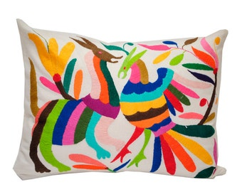 Decorative pillows with embroidered otomi