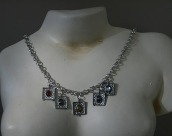 Silver necklace with various stones.