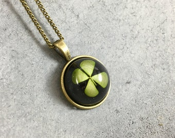 Four Leaf Clover against Black Background in a Dainty Cabachon Antique Bronze Resin Pendant, Resin Necklace