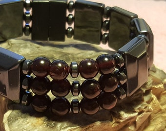 Energy Bracelet Accented with Garnet Beads