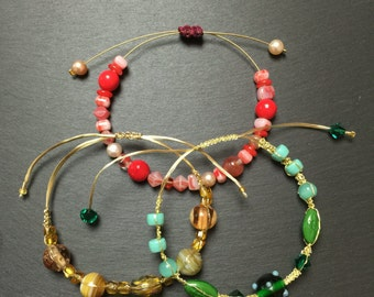 Bracelets in gold and colorful