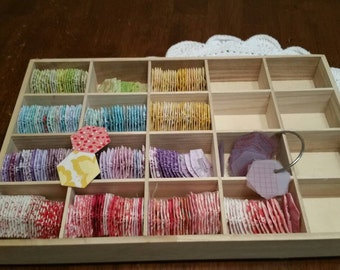 Fabric hexagons and cubby.  300+ pieces