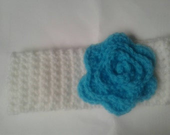 Child's white crochet headband with teal flower