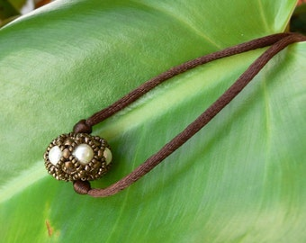Brown fabric and Pearl necklace of Swarovski pearls