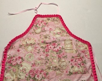 Small child's pink apron