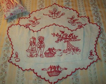 A lovely vacuum former embroidered pocket, small children, geese, apples