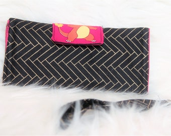 black, gold, and red charmander wristlet wallet with detachable strap