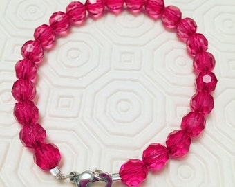 Hot pink glass bead bracelet with heart clasp