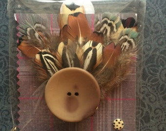 Handmade feather brooches