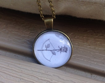 black and white rose/bow and arrow pendant