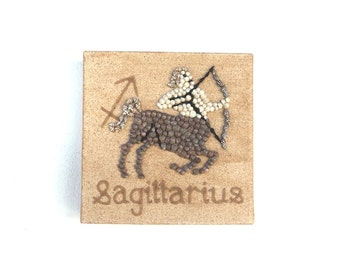 Saggittarius Star Sign in Seashell Mosaic on Sand