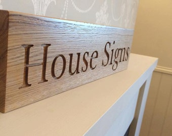Solid oak bespoke house sign - up to six letters.