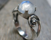 Eidyia ring ... cast sterling silver / spiral scrolls / rainbow moonstone / US ring size 7