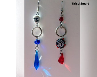Mismatched Pirate skull earrings in red and blue