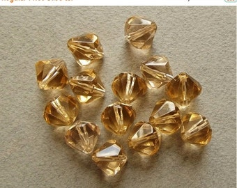 ON SALE Vintage champagne bicone beads