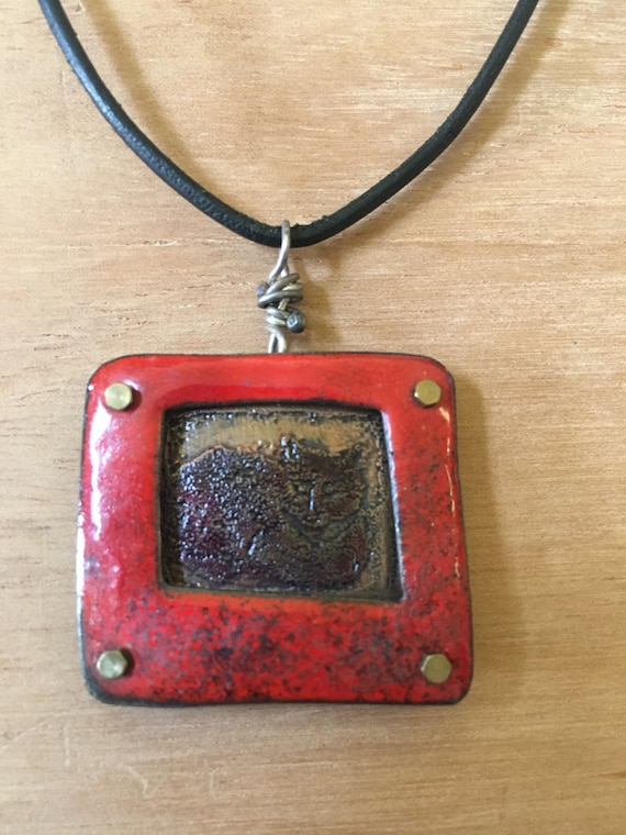 Cat etched in copper with enamel frame dementional; chain length 18 inches (adjustable)
