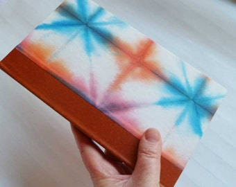 Handbound Journal with blue and orange shibori cover and leather spine
