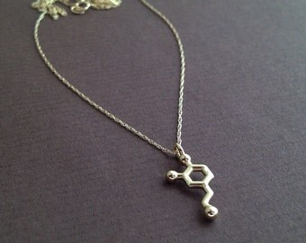 tiny dopamine necklace in solid 14K yellow gold
