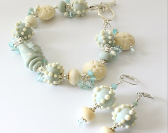 Seashell Lampwork Set,  Bracelet and Earrings, Light Blue, Cream, Sand Dollars, Beach, Ocean, Dusty Blue, Silver Bracelet, Crystals, Aqua