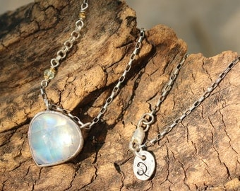 Teardrop moonstone pendant necklace in silver bezel setting and lightly oxidized silver chain