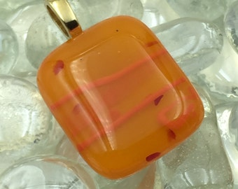 Fused Glass Pendant Shades of Orange with Red Inclusions
