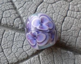 Violet on Ice Green Encased Floral Focal Lampwork Beads by Cherie Sra R114 Encased Floral Flameworked Bead Purple Floral Encased Bead