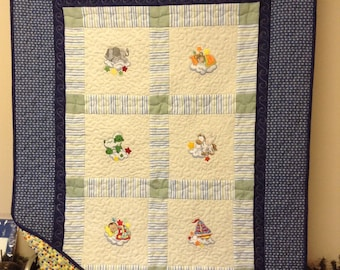Baby boy embroidered quilt in blue with matching pillow