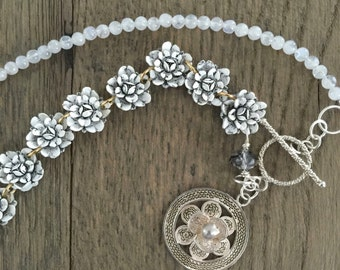 Vintage repurposed one of a kind moonstone bead, celluloid flower and sterling silver filigree flower necklace