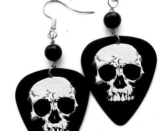 Skull Guitar Pick Pierced Earrings white skulls on black guitar pick hand made wire wrapped pierced dangle earrings by Ziporgiabella