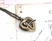 fireman. heart locket necklace. in brass ox jewelry with hat and axe
