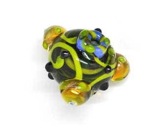 Triangle green lampwork bead with yellow dots