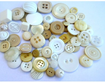 62 Buttons, antique and vintage plastic buttons, white to cream, assorted designs and sizes