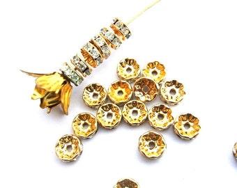 6 Vintage Swarovski rondelle beads clear crystal rhinestone on gold color base 7mm spacer beads