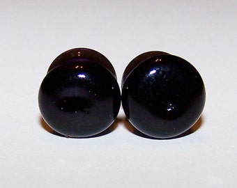 1 gauge pair of black double flared glass plugs (91)