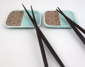 Pair of little aquamarine glazed porcelain dipping dishes with pattern