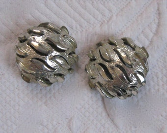 silver colored earrings . coro . coro earrings . MOD earrings