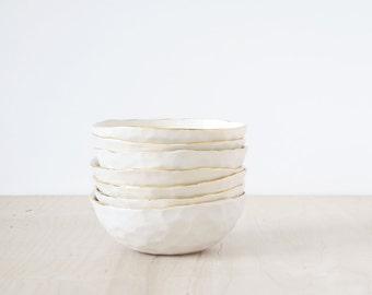 gold rimmed, porcelain mini bowl.